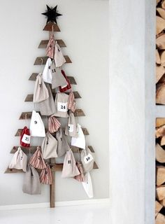 Neat advent calendar...made from pallet wood, little canvas bags with numbers in fabric paint and tiny nails to hang everything on. I love the idea of each bag holding a different object that prompts a story from the Bible about Jesus....preparing our hearts for Christmas and staying focused on what Christmas is really about!