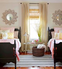 I love this bedroom! Why buy prefab beds when you can hunt down some antiques, paint them, and get double the charm!?