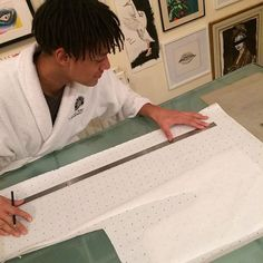 My 17 year old son enjoying his first attempt at pattern cutting. A proud mum moment. @tyleromotoso   ___________________________________ #patterncuttingforbeginners #patterncuttingdeconstructed #patterns #patternpaper #chipofftheoldblock #son