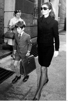 I love this photo Jackie goes for a chic black elegant stylish Outfit with her son! SHe was a true Classic beauty.