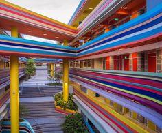 School Building's Vibrant, Multi-Colored Façade Is Reminiscent Of A Rainbow - DesignTAXI.com