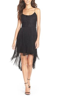 Dancing the night away in this flirty '20s flapper-style fringe sheath dress.