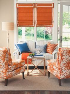 Fabulous roman shades - love the pillows and coffee table I love the beautiful, bright colors. This is a great room.