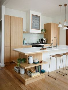 Minimal Modern Bright Kitchen: I love this kitchen, especially that chic island shelf – without it that kitchen could go slightly contemporary.