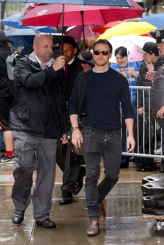 """James McAvoy - New York, NY - May 24 2016. This is titled, """"Really James, you're too dainty to hold your own umbrella"""" come on! ☔️️"""