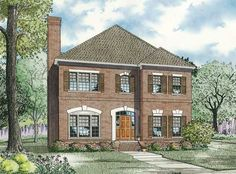 Grand entrance and brick exterior add elegance to this 3 bedroom Colonial style home.  Colonial House Plan # 151863.