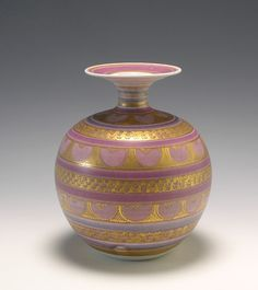The Oakwood Gallery Website Mary Rich.  Large Bulbous Vase  A large and stunning bulbous vase by Mary Rich. Porcelain with a unusual soft pink glaze, gold painted pattern. Impressed with the personal backstamp of Mary Rich. A very desirable vase.    Size: h.21.0 cms Ø.18.0 cms