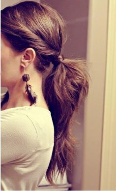 I think I could do this: divide hair from side to side into three parts, middle with the most.  make a low pony with the middle section.  Then take each side section and twist back to the low pony and use to wrap to hide the elastic