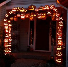 Dishfunctional Designs: Awesome Halloween Home Decorating Ideas Love this idea. Maybe just a column of jack o lanterns. Make from fake pumpkins. Only problem would be storing them.