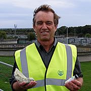 Phosphorous recovery from wastewater.  - Renewable  source of phosphorous from solving the scaling problem of struvite in the process plant - picture Robert F Kennedy Jr at Slough sewage works holding a hunk of struvite, which blocks pipes at the works, and some fertiliser pellets made fro...