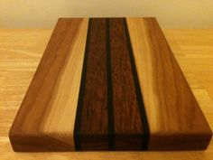 LOVE THIS! Cutting board / Cheese board, handcrafted of cherry, mountain ash and jatoba woods in Cape Breton, Nova Scotia. BEAUTIFUL!