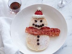 Snowman Pancakes with Bacon Scarves : With just a few extra ingredients (bacon, whipped cream, strawberries and chocolate chips) your regular snow-day pancakes morph into an even more cheerful, on-theme breakfast.