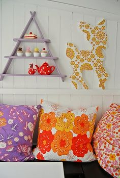 Pretty deer cutout and floral pillows.