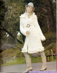 Ivory crocheted coat. Love the leggings and boots too!