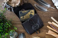 The pouch has room for a vintage tobacco tin in which you can keep your survival or fire kit.