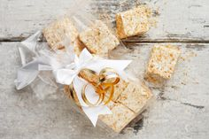Delicious and easy toasted coconut marshmallows, rolled in toasted coconut. Perfect for holiday gifts or for party or wedding favours.