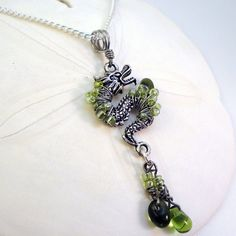 Wire wrapped dragon pendant with glass beads