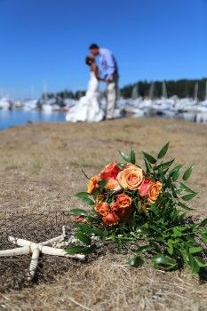 Roche Harbor Bride and Groom - Starfish Bouquet, Marina in the back.  Perfect Nautical Theme Wedding!  By Melissa Miksch Photography - Seattle Area Wedding Photography