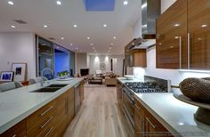 This gorgeous modern kitchen featuring The Garrison Hardwood Flooring have all the equipment you need for a lavish dinner party or a quiet night alone. Pin from thegarrisoncollection.com
