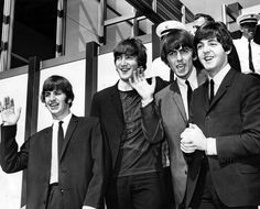 The Beatles greeting fans at LAX during their very first visit to Los Angeles on August 18,1964. (Bizarre Los Angeles)