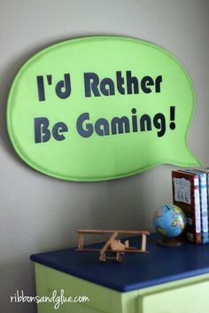 DIY I'd Rather Be Gaming Sign made with heat transfer vinyl, Silhouette Cameo and an IKEA sign. Easy craft idea for any Tween Boys Room.  I have got to make this for A.J.  - it is so him!!!