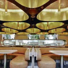 Hand-folded brass hoods with lit tubes.  The Press Club restaurant in Melbourne, Australia by March Studio.