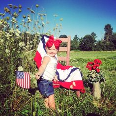 Fourth of July picture idea for baby/kids in a field with a flag