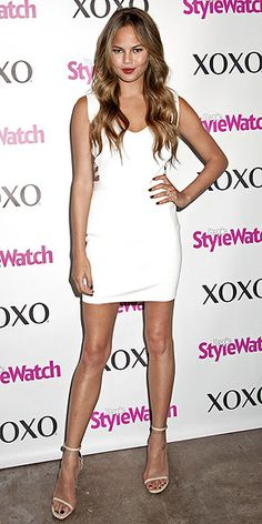 CHRISSY TEIGEN The supermodel kicks off her XOXO campaign in NYC with the help of PEOPLE StyleWatch, a little white dress and some seriously good hair.