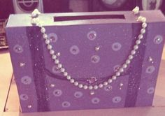 Valentines day purse card box I made for my niece , using cereal box , acrylic paints glitter and rhinestones ..