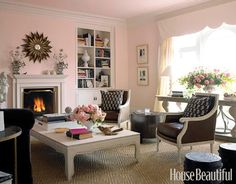 Designed by Stephen Shubel, this living room's walls are painted Benjamin Moore's Bridal Pink, a soft color balanced by the deep browns and the earth textures in the room.