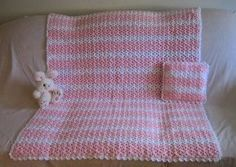 Make a beautiful afghan and pillow set that's perfect for a baby's nursery with one of Roseanna Beck's free and easy crochet patterns.  Pastel pink paired with a shell stitch give this afghan-and-pillow set a delicate, yet intricate look.