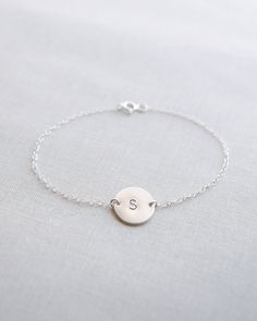 Silver Initial Disk Bracelet makes a great personalized gift for bridesmaids or flower girls. Handmade by Olive Yew.
