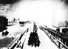 Photos of the great blizzard of 1888: A photo shows New Yorkers hiking across the bridge after being forced to leave their train when it stalled as a result of the heavy snow