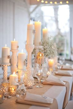 Shabby Chic yet elegant. White wooden candle sticks and mercury glass