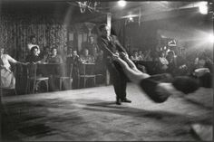 Swing dancing, by Elliot Erwin. Swing dancing got started by just a handful of traveling bands and quickly grew in its' popularity by people looking to take their minds from war and the state of the economy.