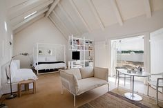 Love the white, the room divider, the bed frame, the daybed/couch against the wall...this room speaks to me!