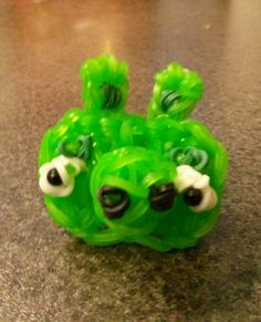 Rainbow loom angry birds charm/character minion pig. My own design. Made on and extended loom placed horizontally. 7 pegs wide and 5 pins high. I love him!!!!