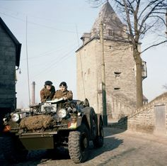 8th Canadian Hussars in a Ferret Scout Car with Osthofentor Tower, east gate, Soest, West Germany. DND photo