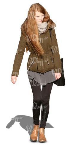 long-haired woman in a khaki parka walking towards the camera