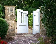 Beautiful garden gate with stone pillars