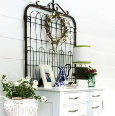 Sometimes junk makes the best art. See how this vintage garden gate was used in the decor of a back porch.