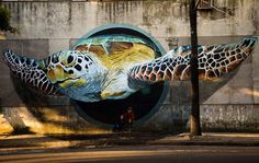 sea turtle street art in Buenos Aires; check out man and dog siting under the turtle!  by artist Martin Ron-  https://www.facebook.com/martinronmural