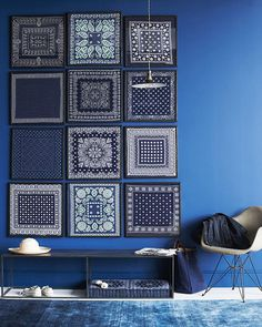 Blue patterned scarves/handkerchiefs as wall art #indigo #interiors #walldisplay