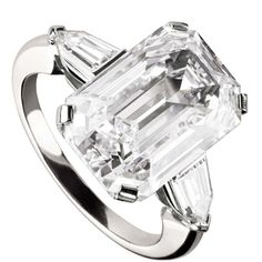 5beab921a20577 Griffe solitaire ring in platinum with emerald cut diamond and two side  diamonds. Available from 1 ct.  BR A classic setting that allows the beauty  and the ...