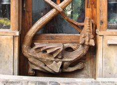 This is the entrance to one of the 400 year old stone houses on the banks of the Vltava River that snakes, like the tail of this dragon, through Cesky Krumlov in the Czech Republic. It's the home of Canadian artist and woodworker Cal Zukowski. More beautiful work in wood at www.naturalhomes.org/art-of-wood.htm