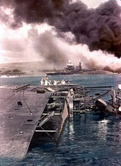 On the morning of 7 December 1941 USS Oglala, flagship of the Pacific Fleet Mine Force, was tied up outboard of the light cruiser Helena. They were alongside Pier 1010 at the Pearl Harbor Navy Yard, with an eight-foot camel between them. Japanese torpedo planes of the first attack wave hit the cruiser with a single torpedo, which ran under Oglala to hit Helena's starboard side. The torpedo's explosion broke through the minelayer's port bilge amidships, and she rapidly took on water.