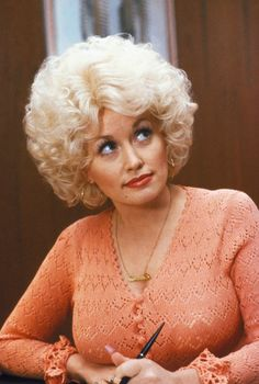 """Regardless of your musical tastes, you can't deny Dolly Parton is a smart, shrewd business woman.  She has """"sold"""" America on her label of being the over-the-top bleached blonde.  All the while she is selling records, getting visitors to Dollywood and keeping her personal life private.  She is a talented song writer, singer and has even dabbled in acting."""