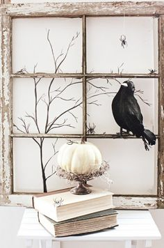 Window pane Halloween Mantle idea; love the books and white pumpkin; so cute!