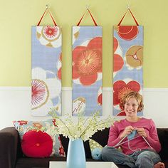 Hanging Panels Instead of hanging fabric panels right on the wall, hang them on hooks. Decoupage the fabric to artist's canvases or plywood. Staple sturdy ribbon to the panel backs for quick hanging.