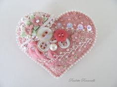Love this mauve felt heart with feather stitching, buttons and beads.